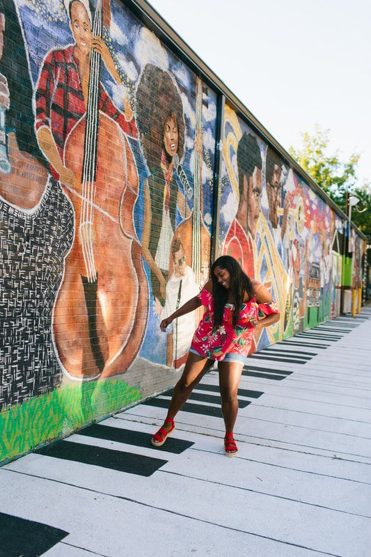 Ashley Dopson in front of her mural at Atlanta Music Project - photo by River West